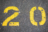 Numerical 20 painted in car park — Stock Photo