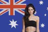 Woman in tube bra against Australian flag — Stock Photo
