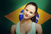 Woman standing in front of Brazilian flag — Stock Photo
