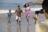 Man video recording Latin family — Stock Photo