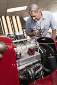 Man looking at car engine — Stock Photo
