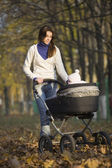 Woman walking with baby — Stock Photo