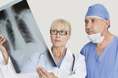 Senior male surgeon and female doctor — Stock Photo