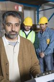Men in factory — Stock Photo