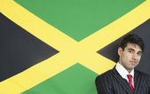 Businessman against Jamaican flag — Stock Photo