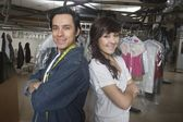 Man and woman  working in laundrette — Stock Photo