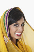 Indian woman with yellow dupatta — Stock Photo