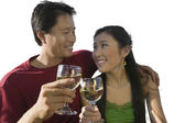 Couple clinking their wineglasses — Stock Photo