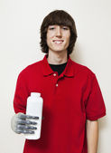 Man holding bottle with prosthetic hand — Stock Photo