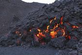 Glowing molten volcanic rock — Stock Photo