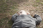 Boy taking a nap on grass — Stock Photo