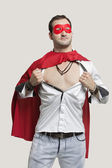Young man in superhero costume — ストック写真