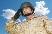 Soldier saluting — Stock Photo