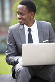 African American Businessman working on a laptop — Stock Photo