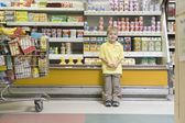 Boy standing by fridge counter — Stock Photo