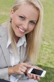 Businesswoman using smart phone — Stock Photo
