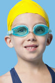 Girl wearing swim cap and goggles — Stock Photo