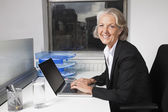 Senior businesswoman using laptop — Foto de Stock