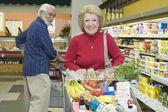 Senior couple doing food shopping — Stock Photo