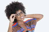 Woman in African print attire wearing glasses — Stock Photo