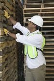 Man inspecting wooden pallets — Stock Photo