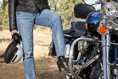 Womans leg on motorcycle — Stock Photo