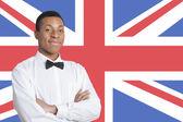 Man against British flag — Stock Photo