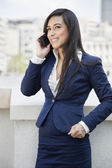 Indian businesswoman using cell phone — Stock Photo