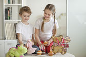 Siblings and soft toys celebrating — Stock Photo