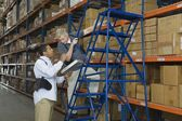 Men working in distribution warehouse — Stock Photo