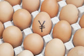 Yen currency sign on egg — Stock Photo