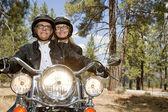 Senior couple riding motorcycle — Stock Photo