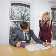 Businesswoman looking at male colleague — Stock Photo