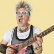 Punk musician playing guitar — Stock Photo #34020597