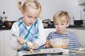 Happy brother and sister baking — Photo