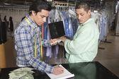 Men working in the laundrette — Stock Photo