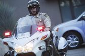 Patrol officer sits on motorcycle — Stock Photo