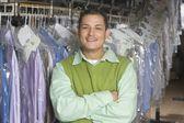Man standing infront of clothes rail — Stok fotoğraf
