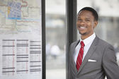 African American young businessman smiling — Stock Photo