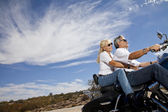 Senior couple riding motorcycle — Stock Photo