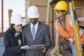 Engineers and female industrial worker — Stock Photo