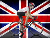 Cyclist cycling in front of Union Jack Flag — Foto Stock