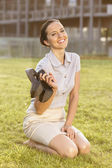 Businesswoman  sitting on office lawn — Stockfoto