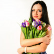 Spring portrait of a lady with a bouquet of tulips — Stock Photo