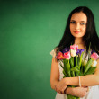 Spring portrait of a woman with tulips — Stock Photo