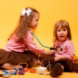 Little girls playing with toys — Stock Photo