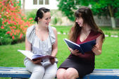 Two students reading books — Stock Photo