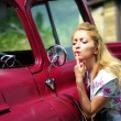 Young lady in vintage dress with the red retro car — Stock Photo