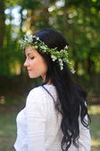 Young woman with long black hair and flower crown — Stock Photo