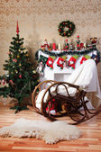 Christmas tree, decorated fireplace and rocking-chair in interior — Stock Photo
